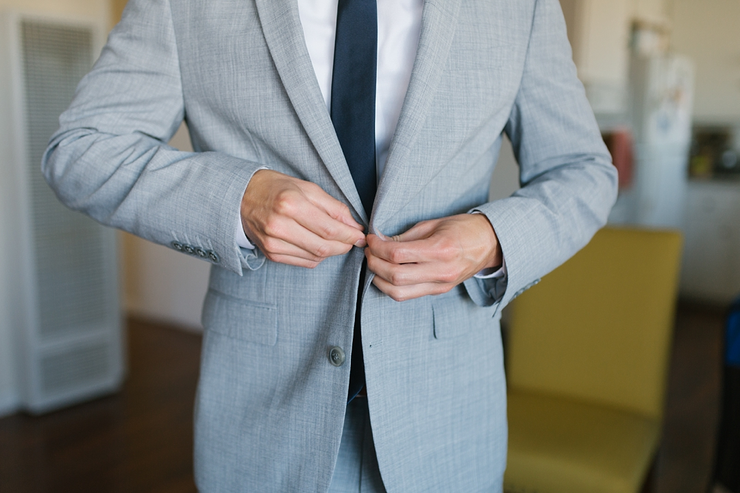 groom buttons grey suit in el segundo