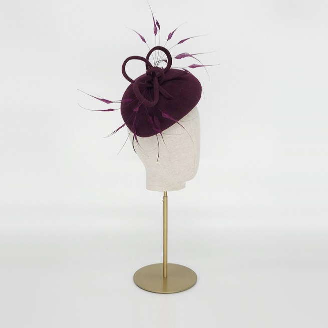 Maroon teardrop with feathers and twist