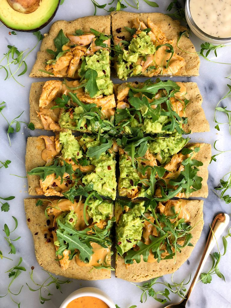 Paleo Guacamole Buffalo Chicken Pizza made with free-range organic chicken and a paleo pizza crust for a delicious gluten and dairy-free pizza recipe!
