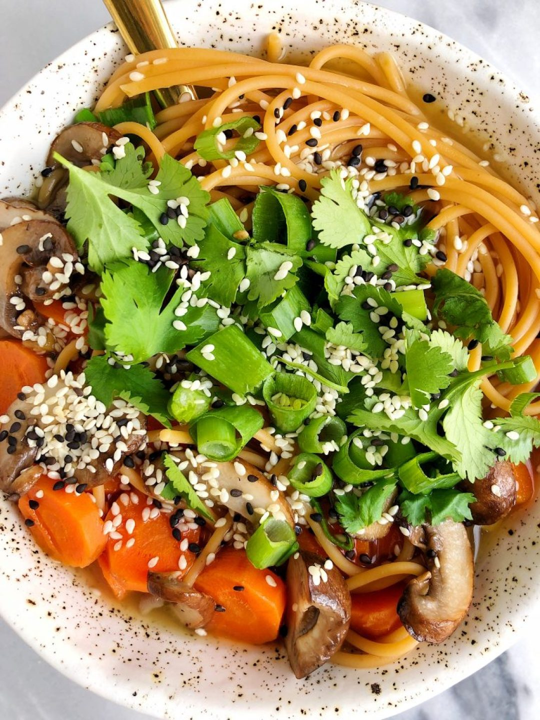 A warm and nourishing Ginger Bone Broth Noodle Bowl made for two with all gluten-free, dairy-free and wholesome ingredients for an easy and healthy soup!