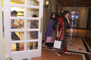 Participants walking in to register