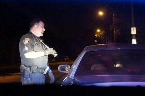 Sgt. Jim  Gardiner, of the Caledonia Police Department, conducts a traffic stop on a car that didn't have its lights on.