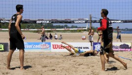 Eric Pupek dives for the volleyball during the EVP Tour in Racine on Saturday an North Beach. (photo by Denise Lockwood)