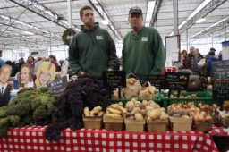 Jordan (left) and Chris Simon, of Simon's Farms, brought several different types of potatoes and kale to sell at Milaeger's winter farmer's market.