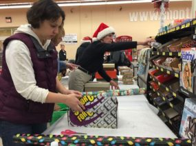 The wrapping station Tuesday at Piggly Wiggly Washington Avenue was busy so deliveries for Santa in a Shoebox can begin Wednesday. Photo credit: Heather Asiyanbi