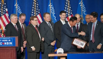 Terry Gou, CEO of Fosconn Technology Group, receives a Wisconsin license plate as a gift from Gov. Scott Walker.
