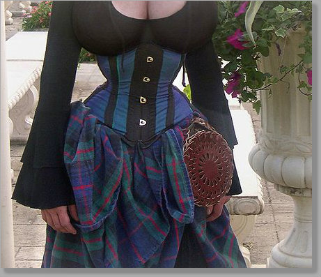 Woman with tiny waist from tightly laced corset.