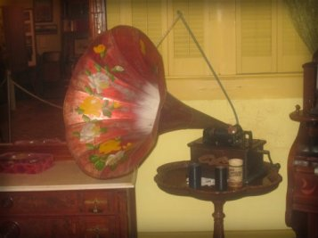 Early Edison Phonograph with black wax cylinder recordings.