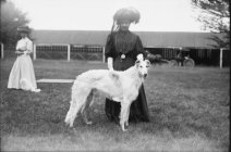 Victorian lady with large dog.