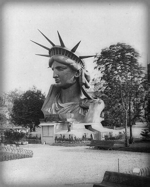 Statue of Liberty's Head in a Parisian Park.