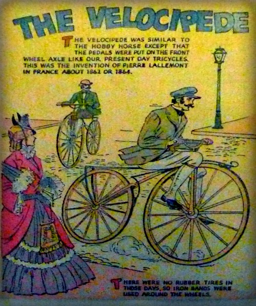 Velocipede Ad with woman watching two 1860s men on velocipede two-wheeled bikes. Image: OldBike.eu.