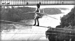 Maria Spelterini on tightrope high above Niagara Falls with long balance beam in hand