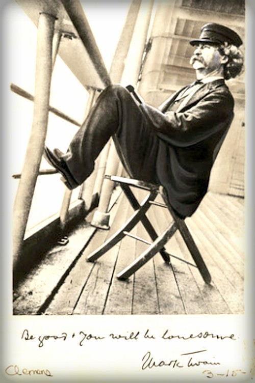 Mark Twain leaning back on a chair with feet on handrail of ship.
