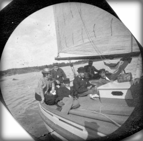 Victorian Era Spy Camera: Carl Stormer black and white photo of six people on a sail boat. Image: wiki-visually.