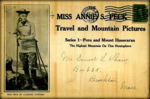 Annie Peck in baggy knee pants and bootsand mountaineering gear on Travel and Mountains Pictures Postcard, circa 1900. Image: Wikipedia.