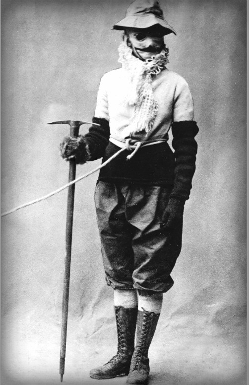 Annie Peck with large black mustache painted on face covering and a Victorian mountaineering hat in 1911. Image: Wikipedia.