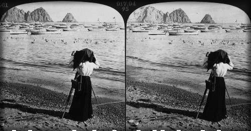 Stereoscopic view of woman photographing Sugarloaf Point at Avalon Bay, 1903. Image: Water And Power.org.