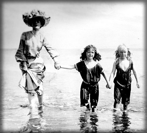 Adult and Two Girls Wading, c. 1900. Image: Library of Congress.