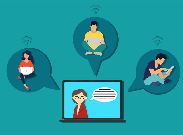 ilustracao de computador no centro simulando uma professora e três alunos em volta - Imagem: Pixabay