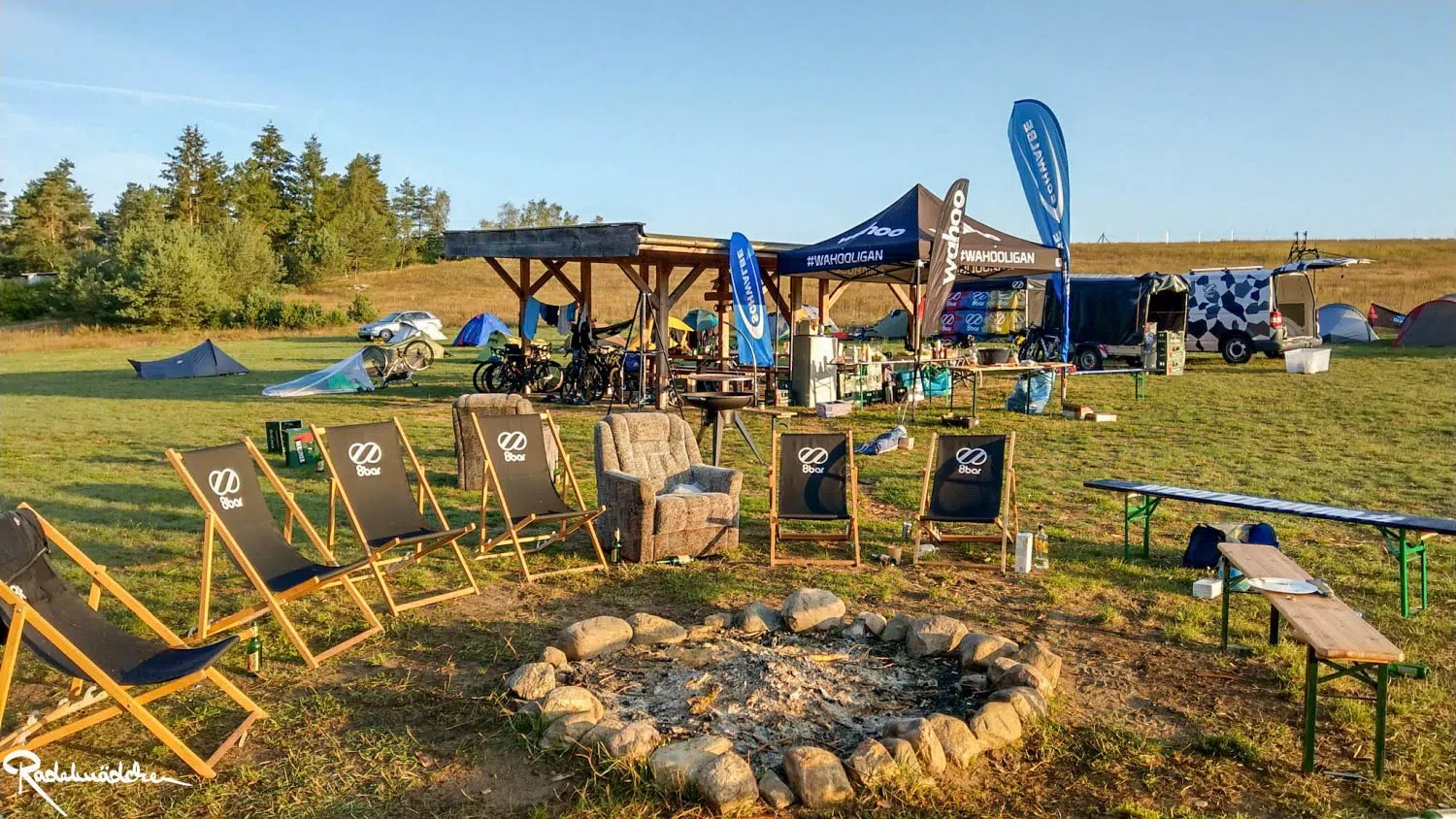 campsite with firepit and chairs