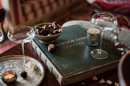 Champagne coupes, old photo album and roasted chestnuts at Askham Hall