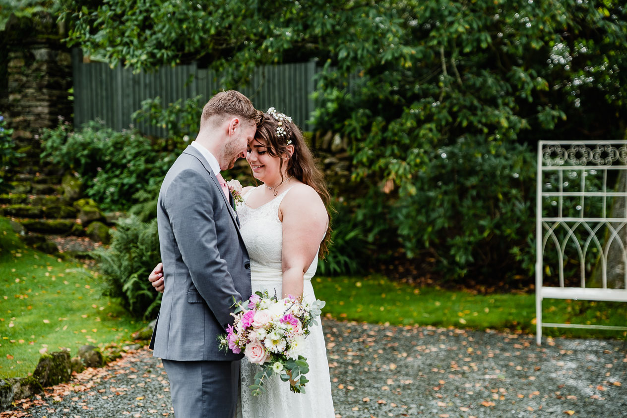 The loving couple gently rest their heads together during Cote How Wedding taken by Lake District Wedding and Engagement Photographer, Cumbria