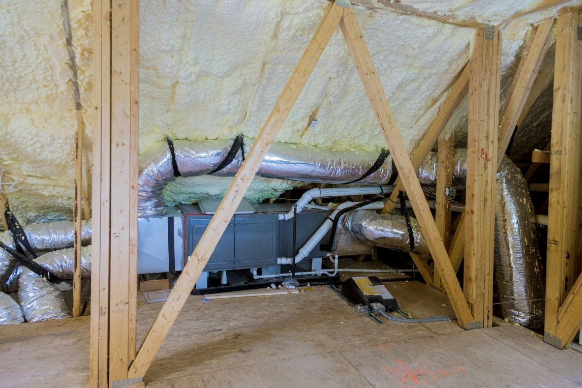 spray foam insulation surrounding an air conditioning unit