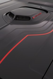 """The Shaker hood scoop is accented on top with a black """"Shakedown"""" badge outlined in red, tying in neatly with custom gloss-black and gloss-red stripes."""