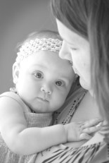 Kristen with baby in black and white