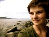 A photo of radical doula Caitlin Caulfield.
