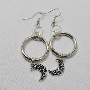 Hanging crescent moons suspended from silver hoop by Piercing Moon Creations