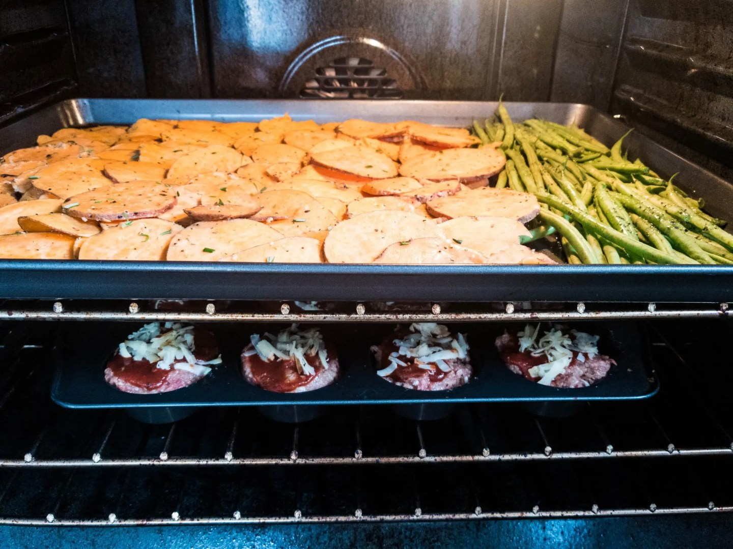 mini meatloaf and veggies meal prep in oven