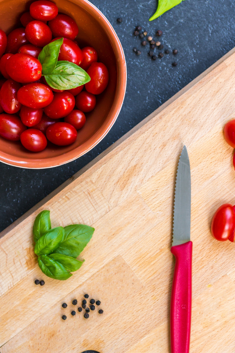 tomatoes and basil on chopping board