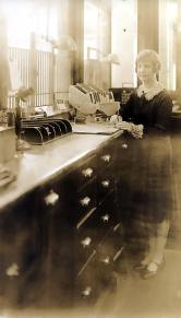 A bank teller from the original bank location.