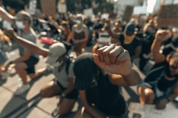 Protesters kneel in solidarity to honor George Floyd. (June 2020)