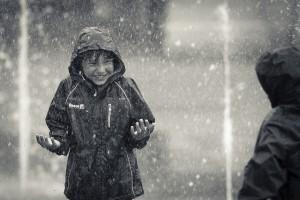 kid-playing-in-the-rain