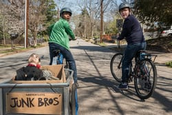 "Sonny (Jeremy Ray Taylor, right) and Sam (Caleel Harris, left) finish loading their ""Junk Bros"" wagon with goods from the abandoned house in Columbia Pictures' GOOSEBUMPS 2: HAUNTED HALLOWEEN."