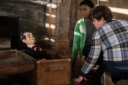 """Sonny (Jeremy Ray Taylor, right) and Sam (Caleel Harris) find """"Slappy"""" in an abandoned house in Columbia Pictures' GOOSEBUMPS 2; HAUNTED HALLOWEEN."""