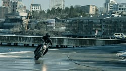 Lisbeth Salander (Claire Foy) speeding across the ice in Stockholm in Columbia Pictures' THE GIRL IN THE SPIDERS' WEB.