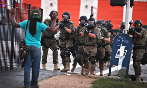 Police confront a protester in St Louis