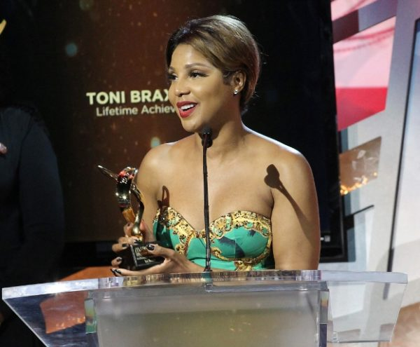 "Legendary R&B songstress Toni Braxton accepts a Lifetime Achievement McDonald's 365Black Award for her commitment to giving back to the community. Other honorees include football cornerback Charles ""Peanut"" Tillman; award-winning actress Wendy Raquel Robinson; and educator and historian Lonnie Bunch, among others. The awards are presented annually to salute outstanding achievements of those who are committed to making positive contributions that strengthen the African-American community. McDonald's 365Black Awards show will premiere September 1 on BET Networks at 9pm EST. (PRNewsFoto/McDonald's USA)"