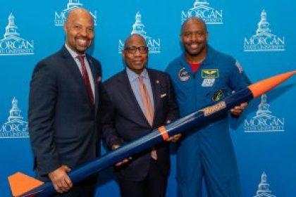 David Wilson, Leland Melvin holding a rocket