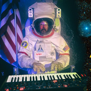 Ambient Sunday image - Tony Gerber in a spacesuit with a keyboard