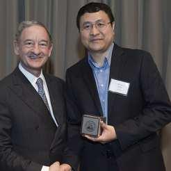 Award recipient Xiaowei Wang, PhD, with Chancellor Mark S. Wrighton.