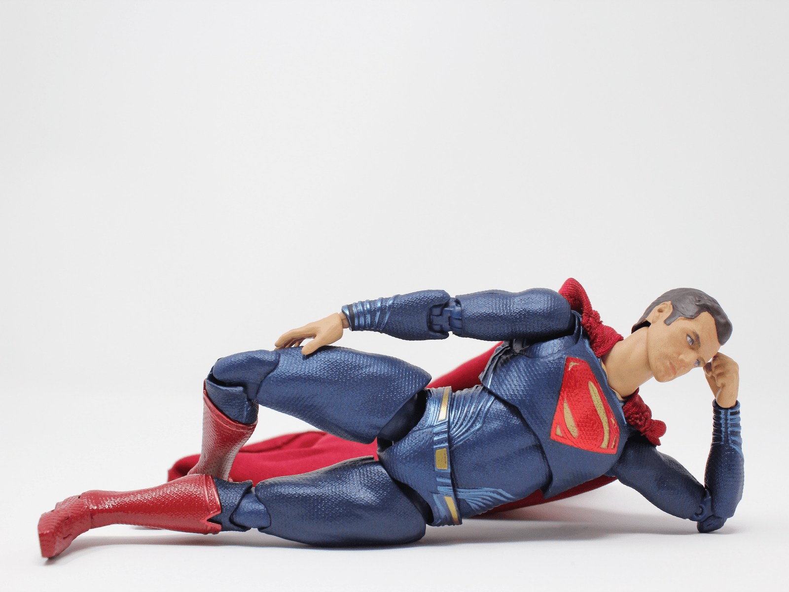 A superhero doll laying down