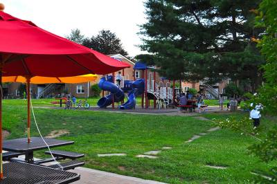 Playground with jungle gym and picnic tables at Radwyn Apartments