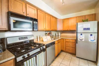Kitchen with wooden cabinets and stainless steel appliances in Radwyn, PA apartments