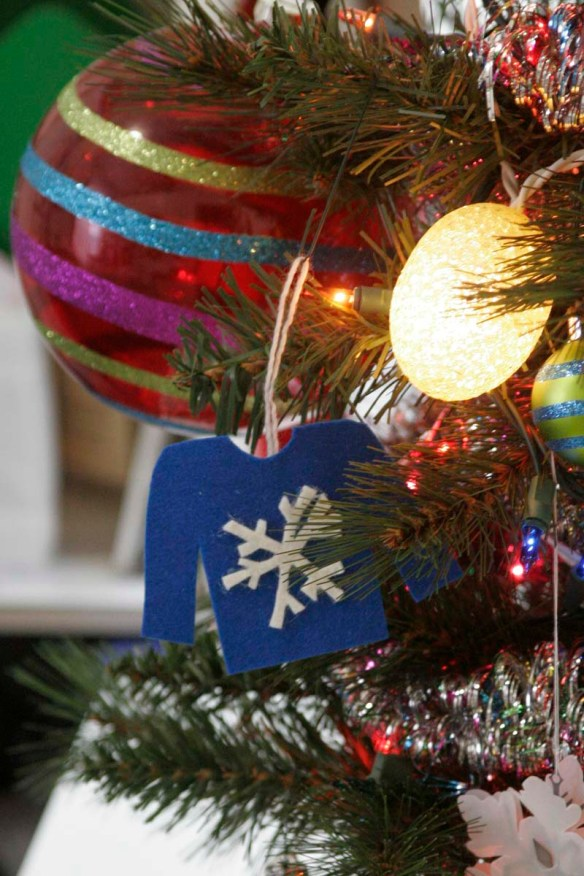 ugly sweater ornament hanging on a christmas tree