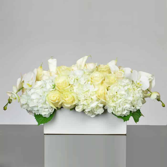 Terrific All White Flowers Centerpiece Of Phalaenopsis Orchids Roses And Hydrangeas Download Free Architecture Designs Scobabritishbridgeorg