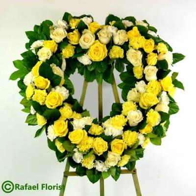 Yellow heart shape flower arrangement for funeral service san rafael ca marin